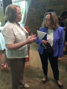 AACF Education Policy Director Jerri Derlikowski (left) chats with Dr. Lombardi at the Little Rock event.